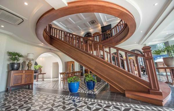 hotel features a wood grand staircase