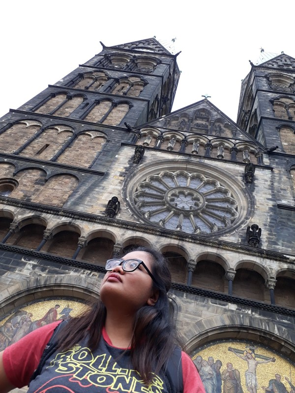 Me in front of the cathedral facade.