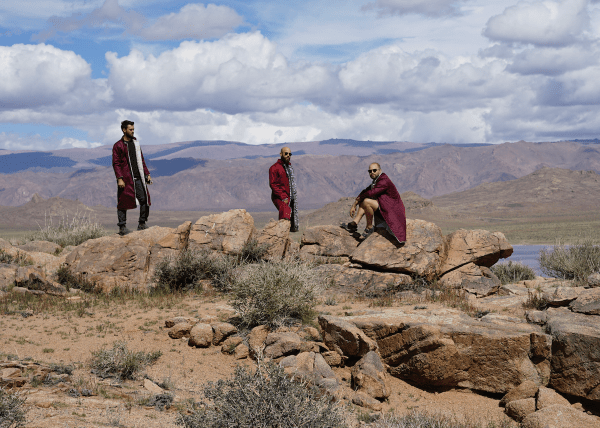 The guys hanging out in some of Mongolia's otherworldly scenery
