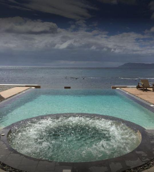Infinity pool overlooking the Balayan Sea.