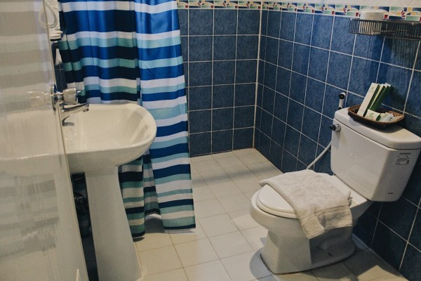 Clean and well-maintained bathroom, equipped with hot and cold showers.