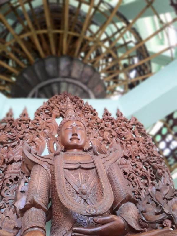 A wooden Buddha inside the Shwedagon Pagoda