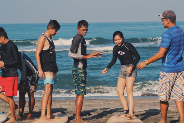 Our fellow bloggers being trained by surf instructors of Final Options before riding the waves.