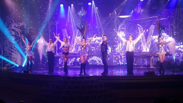 Spectacular magic performance witnessed by other guests boarding Star Cruises.