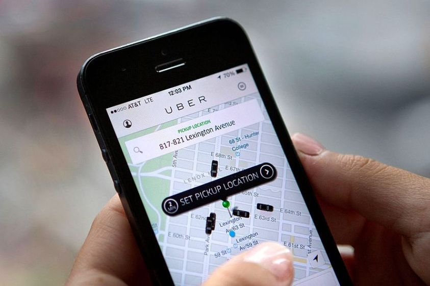 Uber is rumoured to sell its shares to Grab. [Image Credit: Wikimedia Commons]