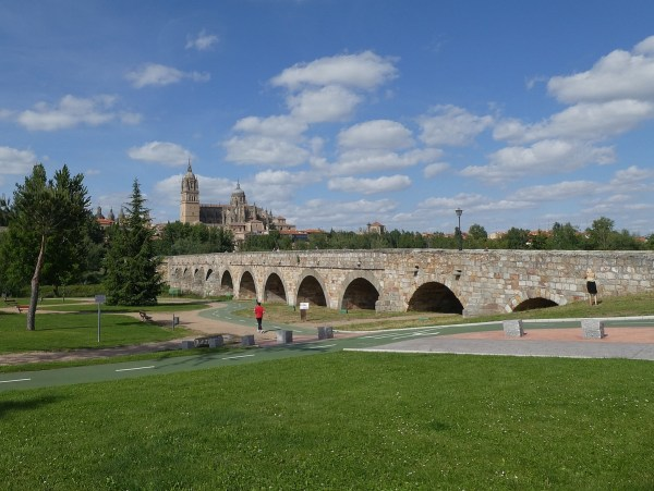 """Ancient Roman bridge into Salamanca, with the """"new"""" Cathedral in the background."""