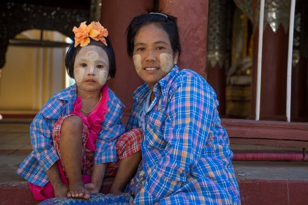 Burmese wearing thanaka on their face - Magnificent Myanmar
