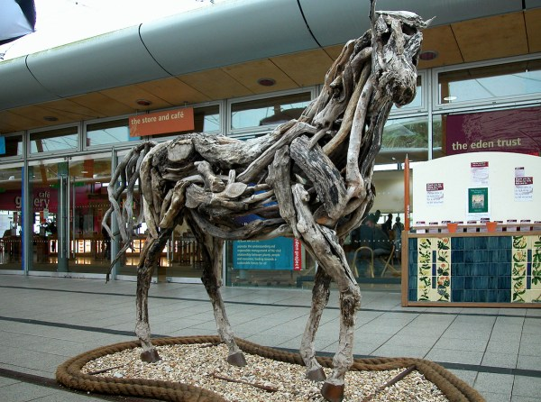 Horse sculpture made of discarded wood at the front entrance of the Eden Project.