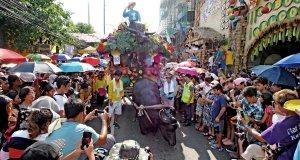 Kneeling Carabao in front of Festival goers