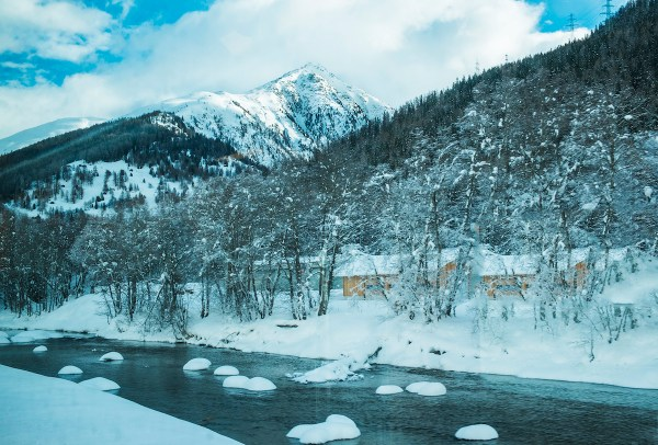 Ice floes on the river beneath the soaring Alps.