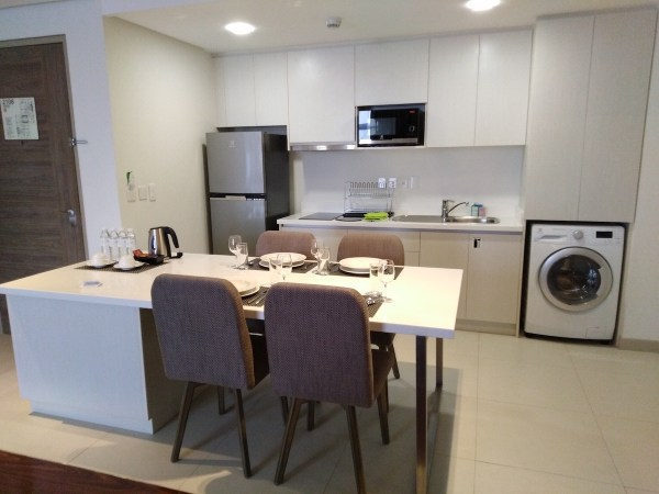 The kitchen, with the laundry machine in view