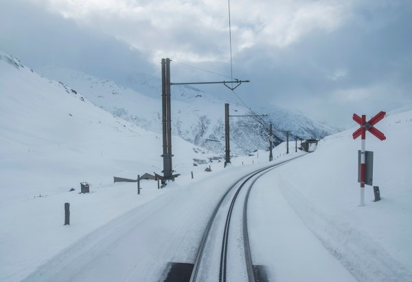 The railroad track slices through the whiteness of the freshly-fallen snow.