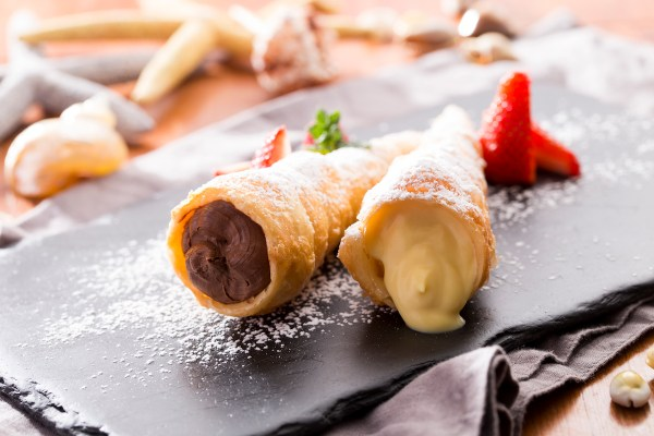 Completing the traditional menu is Basque's famous profiterole-style dessert, Pastry Tubes filled with Chocolate Cream and Vanilla Cream.