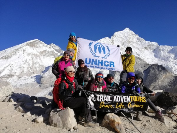 The Trail Adventours team raises the UNHCR flag as they reach Mt. Everest Base Camp. The 10 hikers from the Philippines dedicated their walk to the 2 Billion Kilometers to Safety campaign, to honor the resilience of refugees and forcibly displaced families around the world. (© Coby Sarreal)