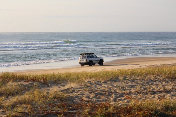 Driving in Fraser Island by Frankie Dixon via Unsplash