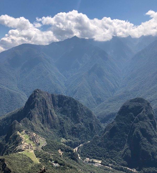 Machu Picchu view from afar by Yuvy Dhaliah via unsplash