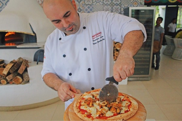 Chef Francesco showing us how to make and cook the Neapolitan Pizza in their wood-fired oven like a pro