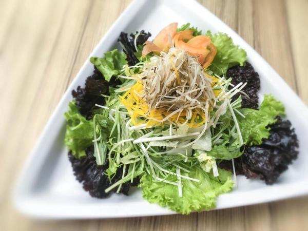 This mouth-watering Gobo & Pumpkin salad is a great way to start your meal.
