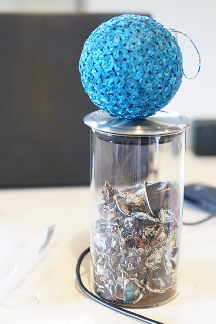 Negrense Volunteers for Change (NVC) artisans upcycle Nespresso coffee capsules into ornaments and keepsakes like this Rosa Rio ball which consists of 135 individually folded aluminum coffee capsules to form these most intricate roses.