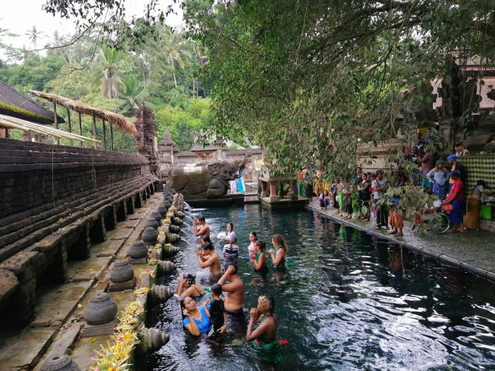 People participating in the bathing ritual in Tirta Empul Temple