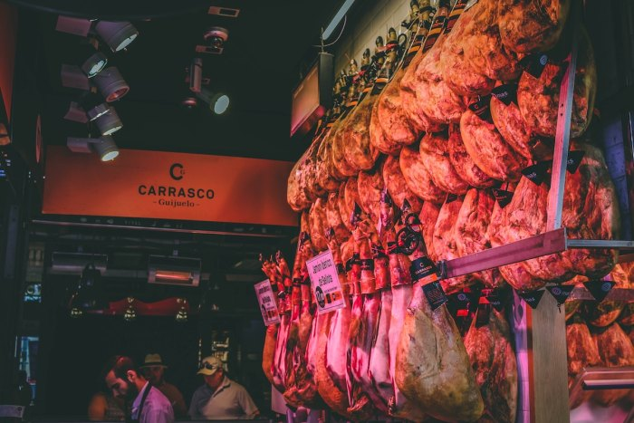Jamon on display at Mercado de San Miguel, Madrid, Spain photo by @victor_g via Unsplash