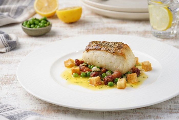 Pan Roasted Chilean Sea Bass Garden Peas and Pancetta Herb with Lemon Butter Sauce