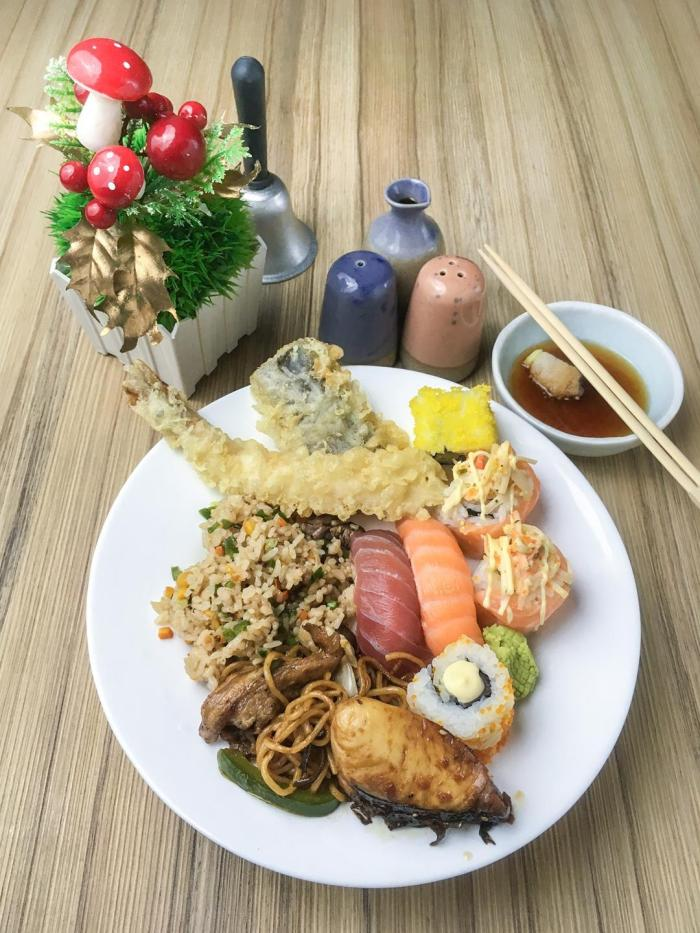 This plate is filled with the sumptuous options from the buffet spread