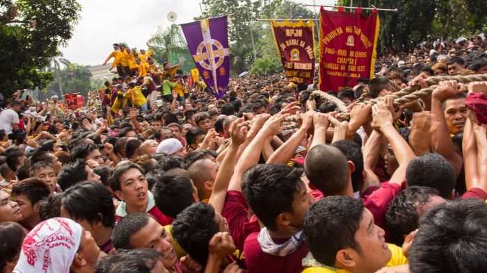 Thousands of Catholic devotees join the procession of the life-size statue of the Black Nazarene during the annual procession in honor of the centuries-old icon of Jesus Christ.