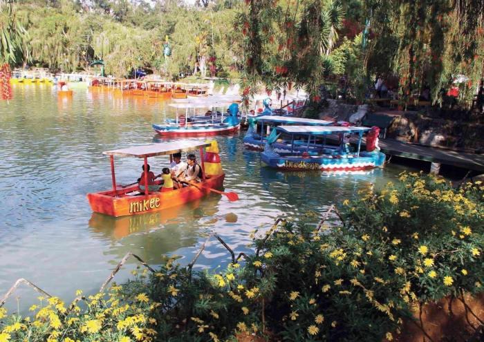 Tourists enjoying the serene waters of Burnham lake