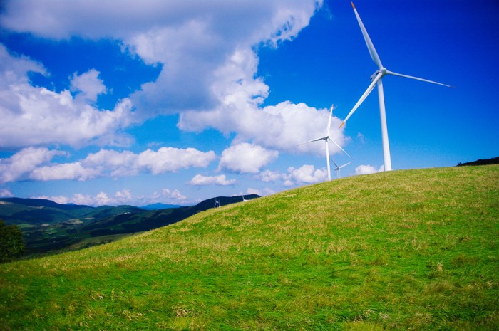 Windmills for electric power on a green hill farm and blue sky white cloud in Daegwallyeong, Pyeongchang, South Korea