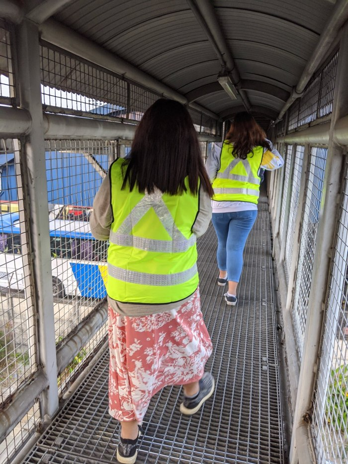Walking on the catwalk to the toll booths