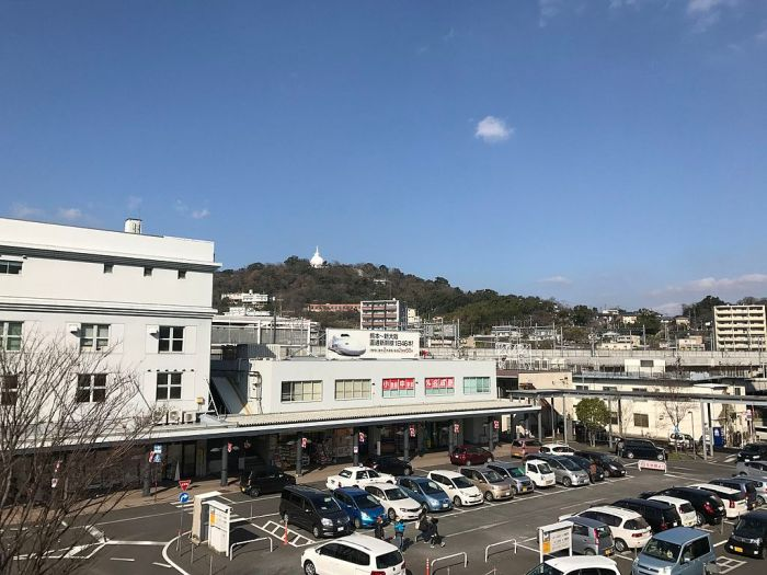 View of Mount Hanaokayama from pedestrian deck in front of Kumamoto Station