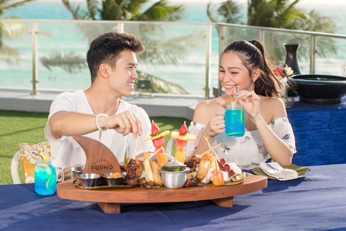 Happy Summer Offer in Discovery Shores Boracay and Club Paradise Palawan comes with a hearty boodle fight lunch for two