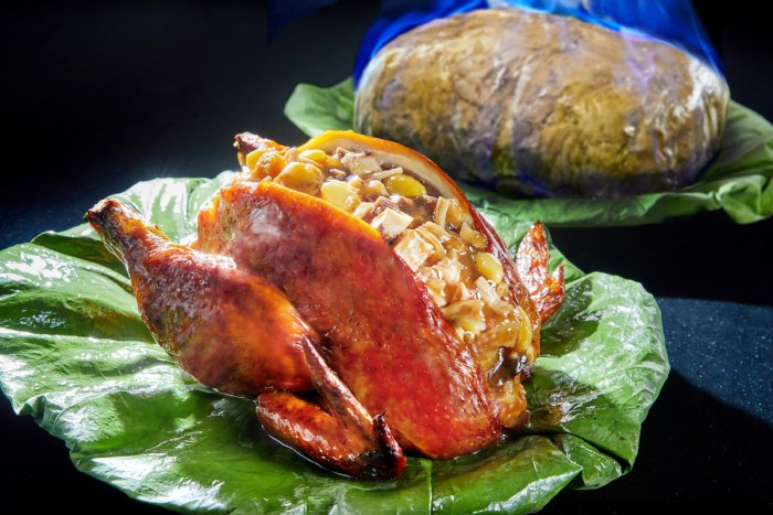 One of Greater China Club's popular dishes, The Flaming Fortune Chicken, invites guests to open from its casing with a 'golden hammer', is offered at just HK$188 (originally priced HK$788) for dinner section