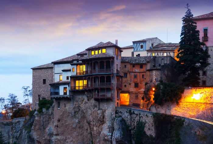 Early morning view at Hanging Houses on rocks in Cuenca. Spain photo via DepositPhotos.com