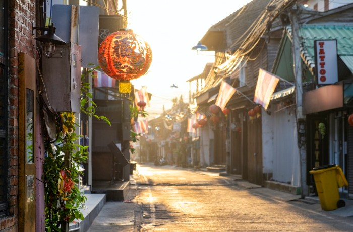 Street in Bophut Fishermans village in the early morning at sunsise, Samui, Thailand photo via Depositphotos