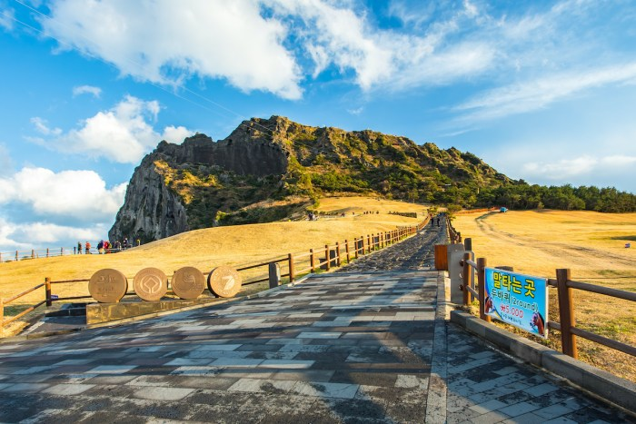 View of Seongsan Ilchulbong moutain in Jeju Island, South Korea. photo via DepositPhotos