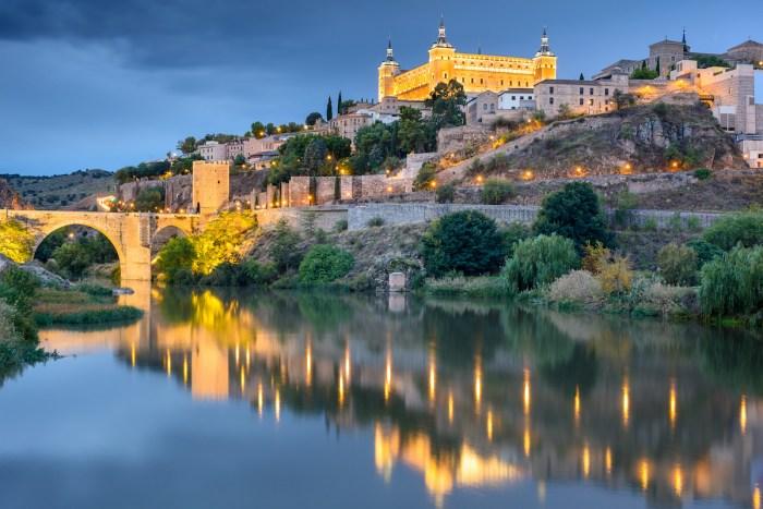 Alcazar de Toledo at Night photo via Depositphotos