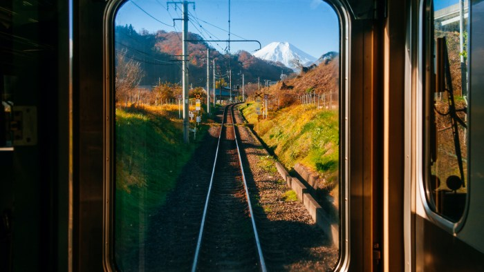 Autumn scenery along train tracks railroad in Japan via DepositPhotos