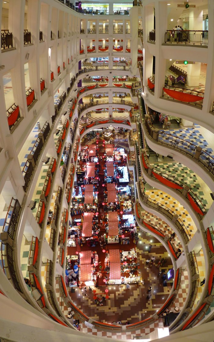 Main atrium of Berjaya Times Square Kuala Lumpur shopping mall by Cmglee via Wikipedia CC
