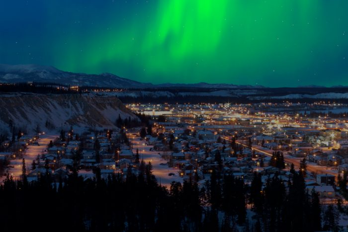 Northern Lights over Downtown Whitehorse photo via Depositphotos