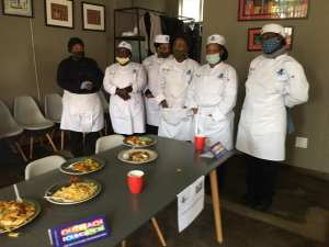 The students from Outreach Foundation's cooking course with their final dishes