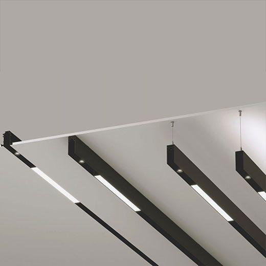 Sistema de iluminación arquitectónica con carriles magnéticos