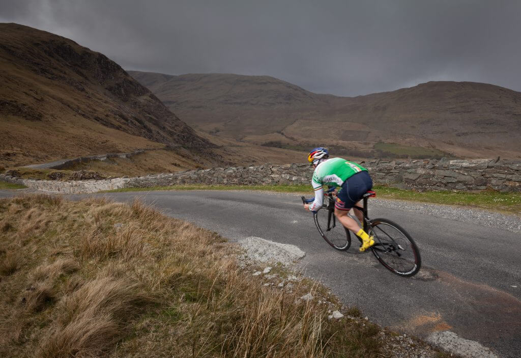 Triathlete Con Doherty cycling in the Doolough Valley, County Mayo, Ireland.