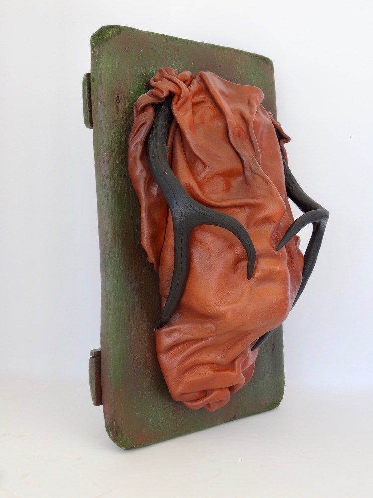 """Title The Man on the Bus Medium Mixed Media Assemblage, wet molded leather, antique objects Size 16""""H x 10""""W x 6""""D"""