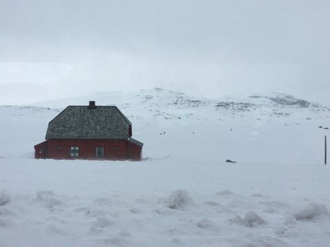 beautiful red barn in norway snow