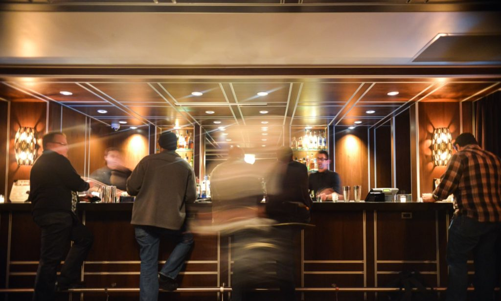 Patrons enjoy themselves at a hotel lobby bar. Perfect space for a Hotel Photo Booth powered by OutSnapped