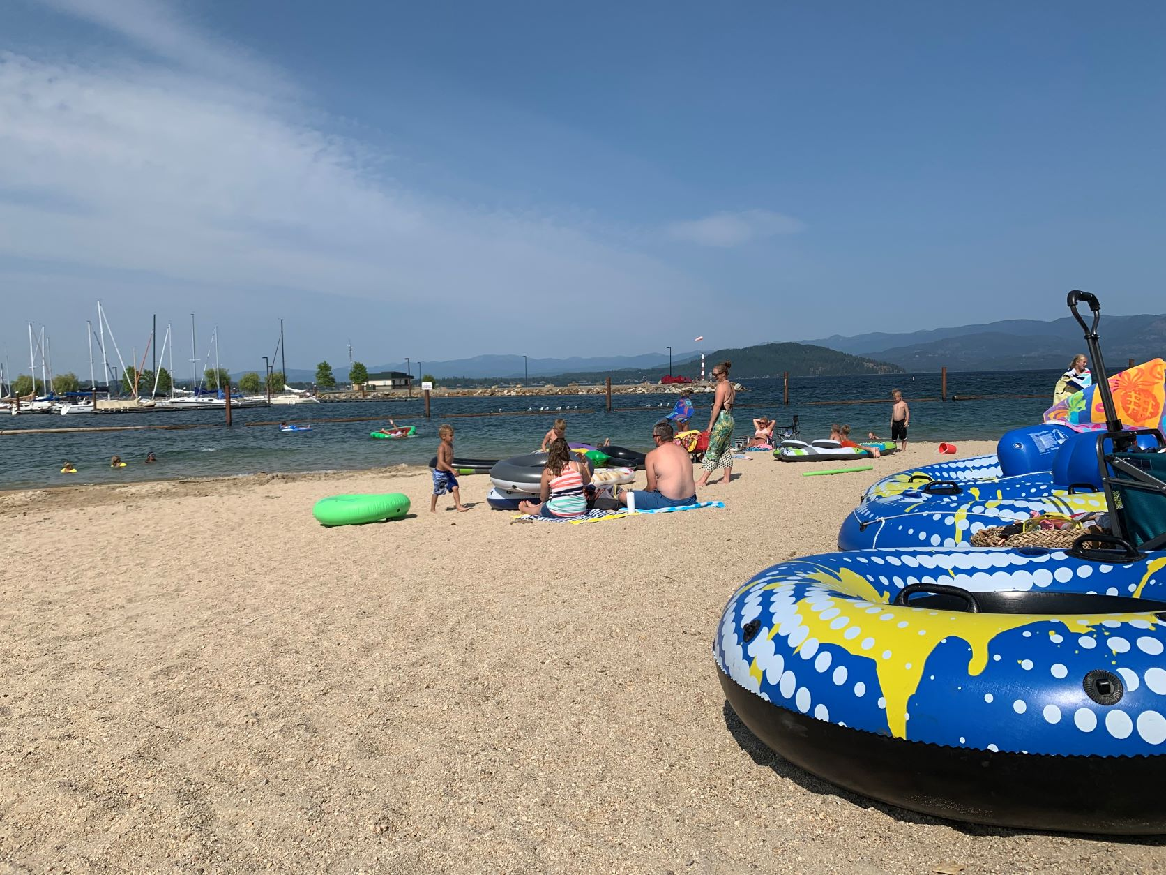 Families on the sandy City Beach in Sandpoint along Lake Pend Oreille.
