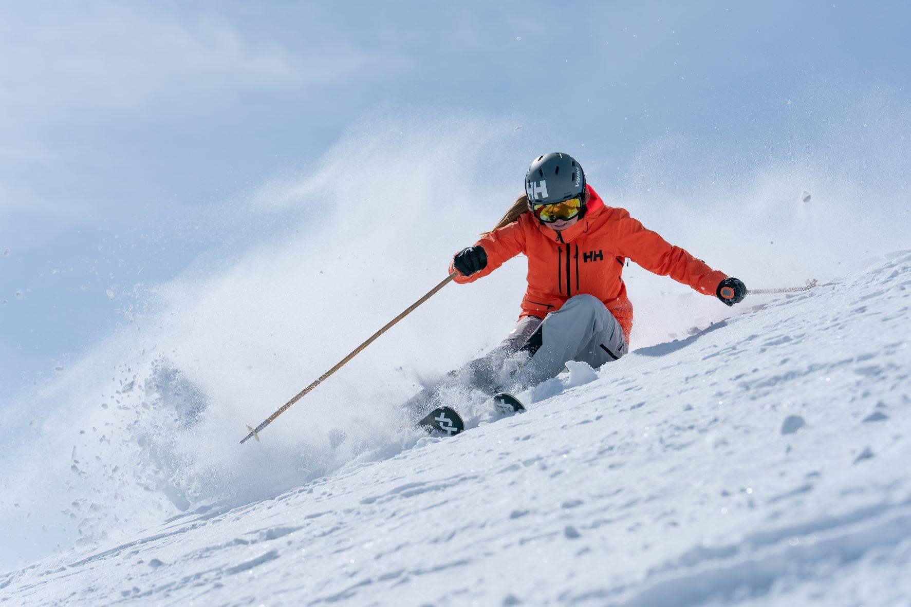 Kaylin Richardson skiing a steep turn at Sun Valley