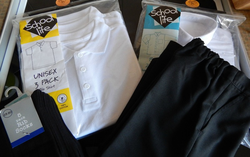 8debfe51f We received a pack of black socks size 9-12, perfect for a size 11 Monkey,  a 3 pack of white polo shirts – age 4-5, trousers in age 5 and some  long-sleeved ...